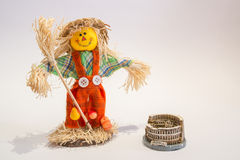 A funny colorful scarecrow with the coliseum. A funny colorful scarecrow with the eifel tower Royalty Free Stock Photos
