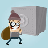 Funny comic burglar with safe in the background Stock Photo