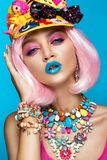 Funny comic girl with bright make-up in the style of pop art. Creative image. Beauty face. Stock Photo