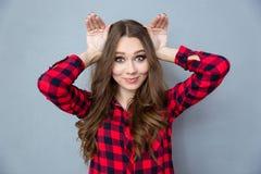 Funny comic girl posing and having fun. Funny curly comic girl in plaid shirt posing and having fun stock image