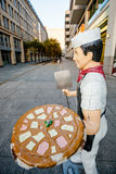 Funny commercial - pizza man statue, Berlin, Germany Stock Photo