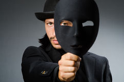 Funny concept. With theatrical mask Royalty Free Stock Photography