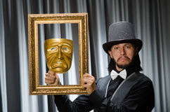Funny concept with theatrical. Mask Royalty Free Stock Photo