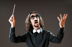 Funny conductor against dark Royalty Free Stock Photography