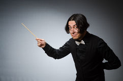 Funny conductor in musical concept Royalty Free Stock Image