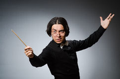 Funny conductor in musical concept Stock Image
