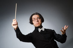 Funny conductor in musical concept Stock Photos
