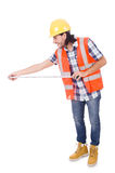 Funny construction worker with tape-line isolated Royalty Free Stock Image