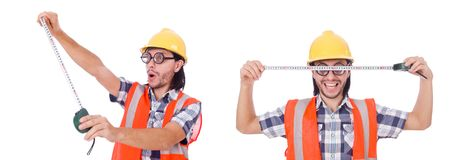 Funny construction worker with tape-line isolated on white. Foreman with tape-measure isolated on white Royalty Free Stock Images