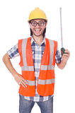 Funny constructon worker with tape-line isolated Royalty Free Stock Images