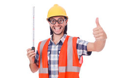 Funny constructon worker with tape-line isolated Stock Photo