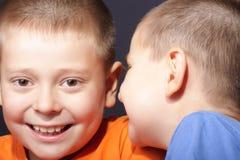 Funny conversation. Two boys have funny conversation closeup portrait stock photos