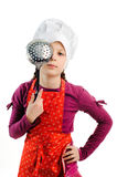 Funny cook. An image of a girl with a colander in her hands royalty free stock photo