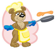 A funny cook-bear is frying pancakes Stock Image