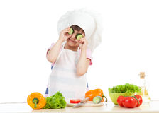 Funny cook child girl cooking at kitchen Stock Images