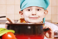 Funny cook and pan. Funny smiling cook face soiled with flour and red pan Royalty Free Stock Image