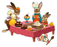 Funny cooking scene with rabbits making sweets Stock Image