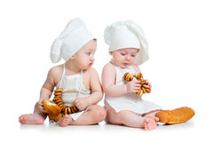Funny cooks babies boy and girl Stock Images