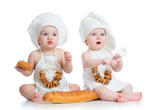 Funny cooks kids boy and girl. Funny cooks children boy and girl Stock Photography
