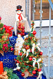 Funny and cool snowman. Funny and cool snowman near a decorated with little Christmas trees standing on the steps of the house. This can be a Christmas gift Royalty Free Stock Photography