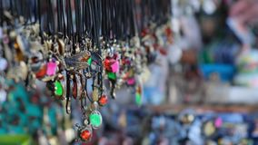 Funny costume jewelry in the gift shop, on the street. Funny costume jewelry in the gift shop, on the street, panorama with a small depth of field stock video