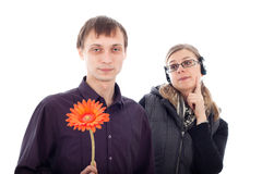 Funny couple. Funny nerd men holding flower and rebel women looking at him, isolated on white background Royalty Free Stock Photos
