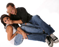 Funny Couple. Funny and cute couple covering each others mouth and eyes royalty free stock image