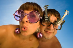 Funny couple. Is making faces with smile Stock Image