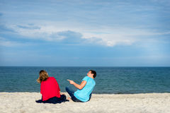 Funny couple on a beach Royalty Free Stock Images