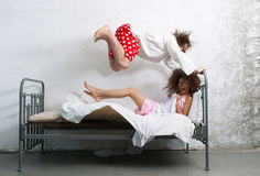 Funny couple in the bed Royalty Free Stock Photography