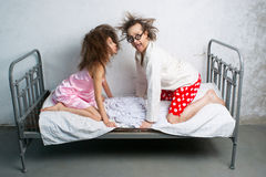 Funny couple in the bed Stock Photography