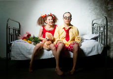 Funny couple on the bed Royalty Free Stock Images