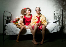 Funny couple on the bed Royalty Free Stock Image
