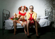 Funny couple on the bed Royalty Free Stock Photography