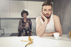 Funny couple after breakfast. Strange faces. Young men and beauty women in kitchen royalty free stock photos