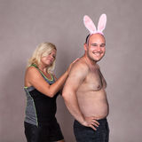 Funny couple with bunny ears stock image