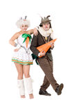 Couple with carrot dressed as rabbits Royalty Free Stock Photography