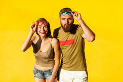 Funny couple in casual style clothes and color glasses Stock Photography