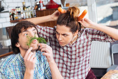 Funny couple cooking and having fun together on kitchen Stock Image