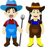 Funny couple farmer cartoon holding rake Royalty Free Stock Images
