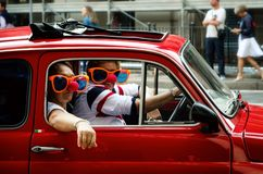 Funny couple in a Fiat 500 classic car