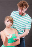 Funny couple fighting over the TV remote Royalty Free Stock Images