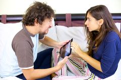 Funny couple fighting for tablet Royalty Free Stock Photo