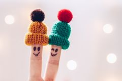 Free Funny Couple Fingers On Knitted Winter Warm Hats Smiling And Win Stock Photos - 104289243