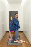 Funny couple getting dressed in pijamas Royalty Free Stock Images