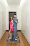 Funny couple getting dressed in pijamas Stock Photography