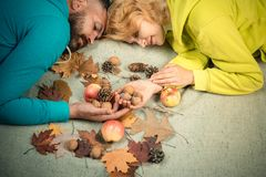 Funny couple are getting ready for autumn sale. Autumn couple wearing in autumn clothes and looks very sensually. Couple royalty free stock images