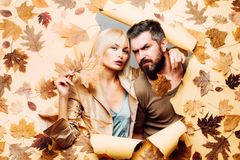 Funny couple are getting ready for autumn sale. Couple in Love wearing in fashionable seasonal clothes having Autumnal. Mood. Beautiful tender couple advertise royalty free stock photography