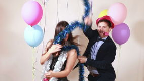 Funny couple having fun dancing with props. Funny crazy couple having fun dancing with props in party photo booth stock footage