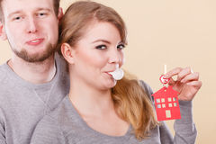 Funny couple holds keys to new home Stock Images
